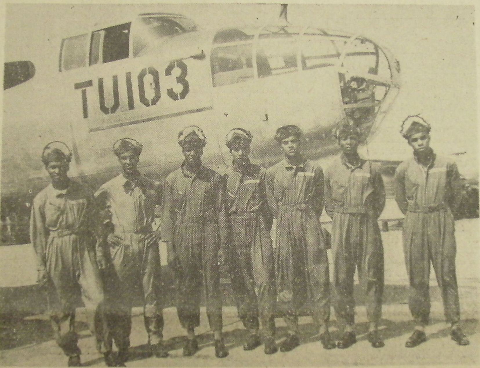 Along with a group of six others, New Orleanian native Russell F. Desvignes graduated from the Tuskegee Field on April 16th 1945.From left to right the Airmen are: F/O James H. Taylor, Champaign, Ill.; 2nd Lt. Lowell H. Jordan, New York, NY; F/O Leroy Criss, Los Angeles, Calif.; F/O George G. Norton, St. Louis, Mo.; 2nd Lt. Theopolis W. Johnson, Birmingham, Ala.; F/O Russell F. Desvignes, New Orleans, La.; F/O Eldridge Freeman, Chicago, Ill. (Official U.S. AAF Photo by AAF Training Command.)